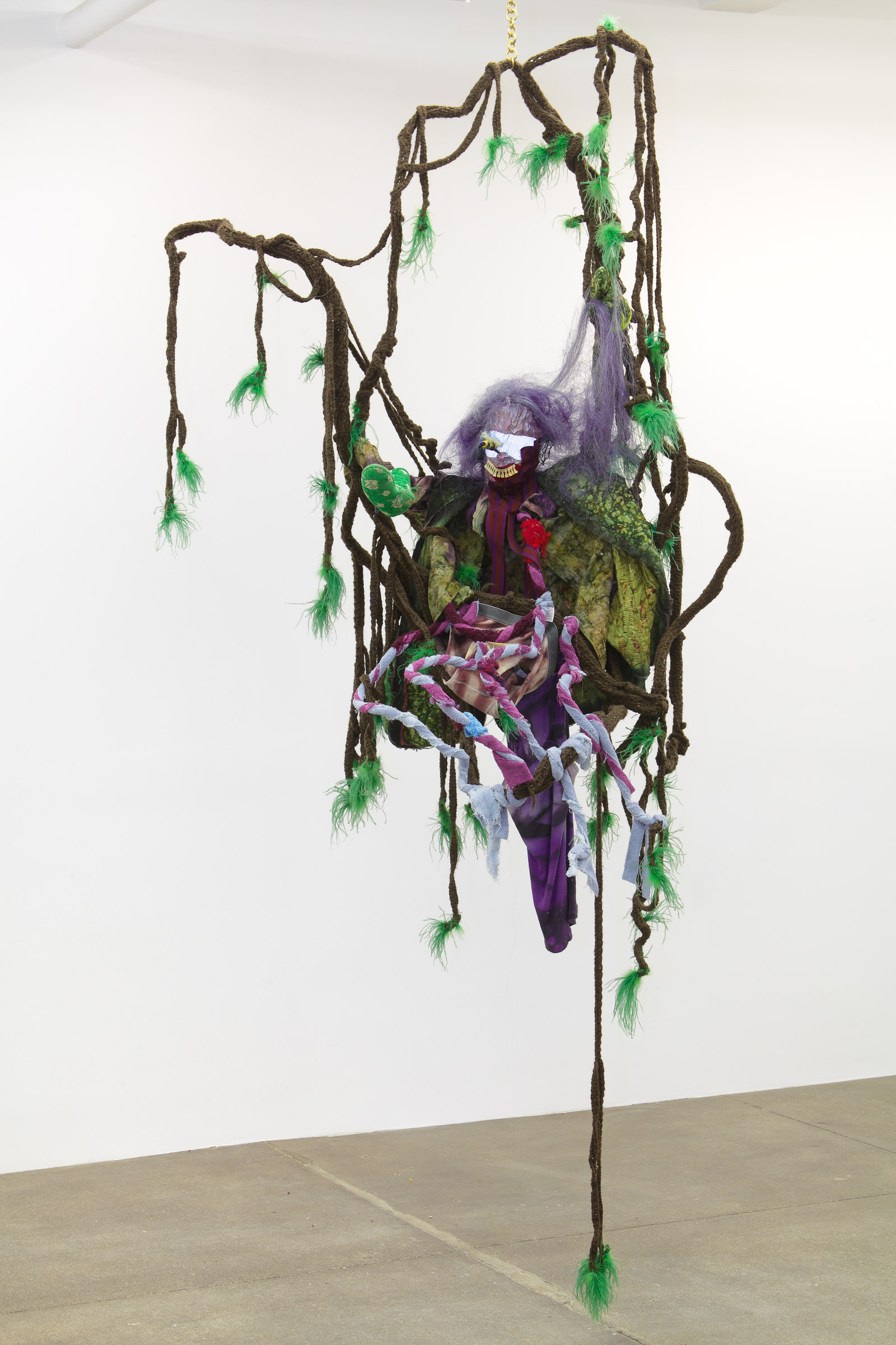 Look me in the eye (Felted wool, coat hanger, reflective material, vintage millinery tubing, vintage fabric, towel, feather, horse hair, hand-dyed under garments, aluminum tubing, brass chain, 2011-2013)